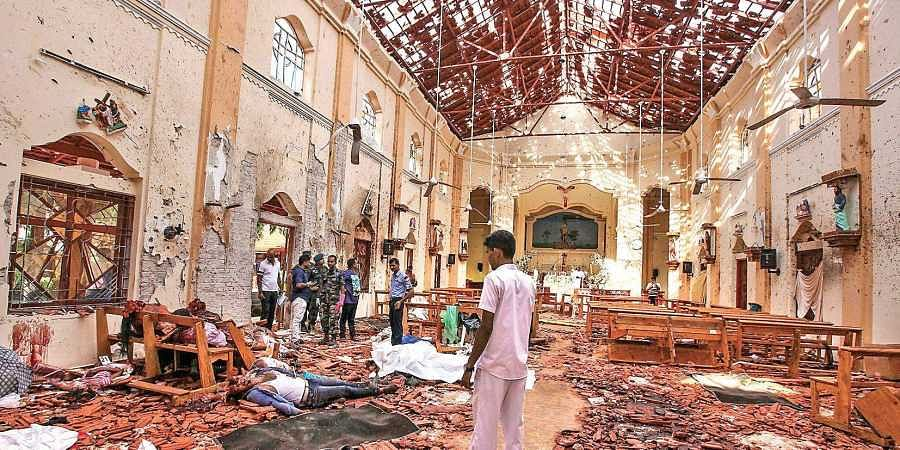 Dead bodies of victims lie inside damaged St. Sebastian's Church in Negombo