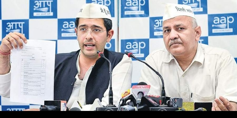 AAP's Raghav Chadha with Deputy CM Manish Sisodia during a press conference in New Delhi on Saturday