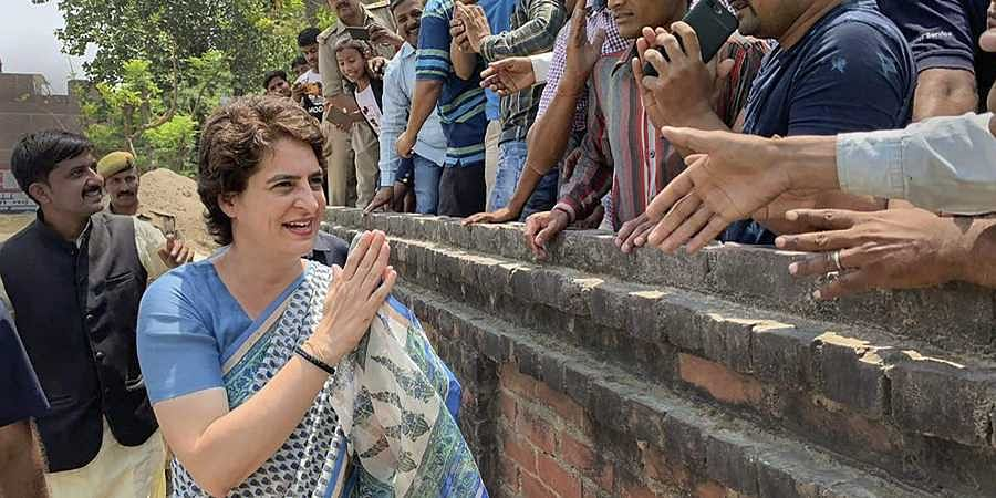 Congress General Secretary Priyanka Gandhi Vadra meets her supporters during an election campaign for Lok Sabha elections. (Photo | PTI)