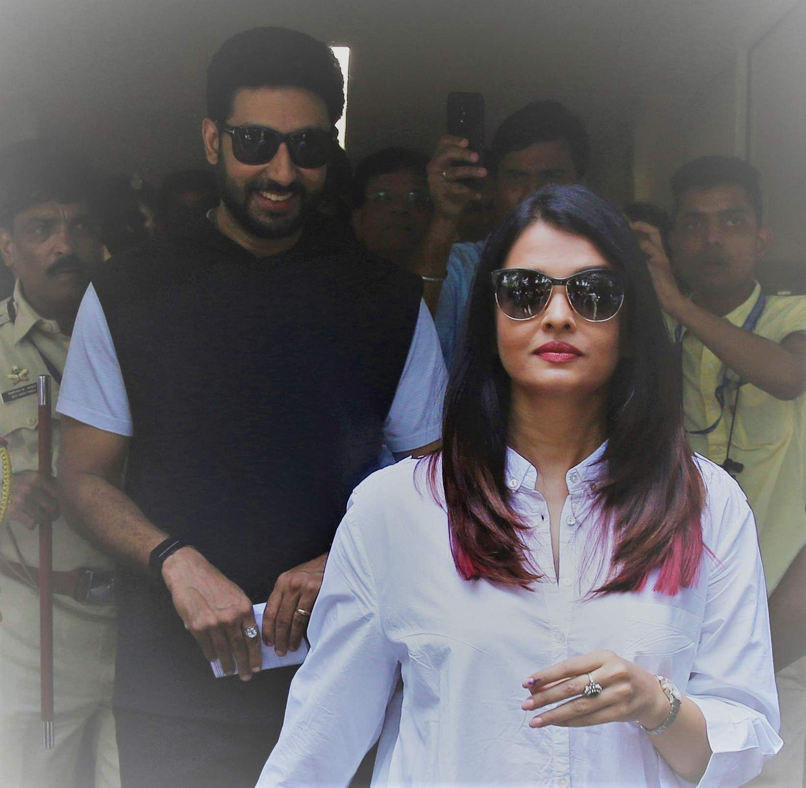 Bollywood star Aishwarya Rai, front, along with husband Abhishek Bachchan leaves after casting their vote at a polling station in Mumbai.