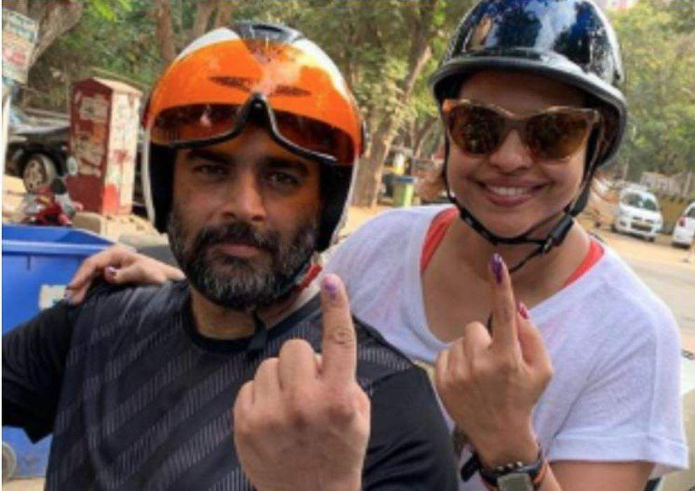 Madhavan with wife after casting vote.