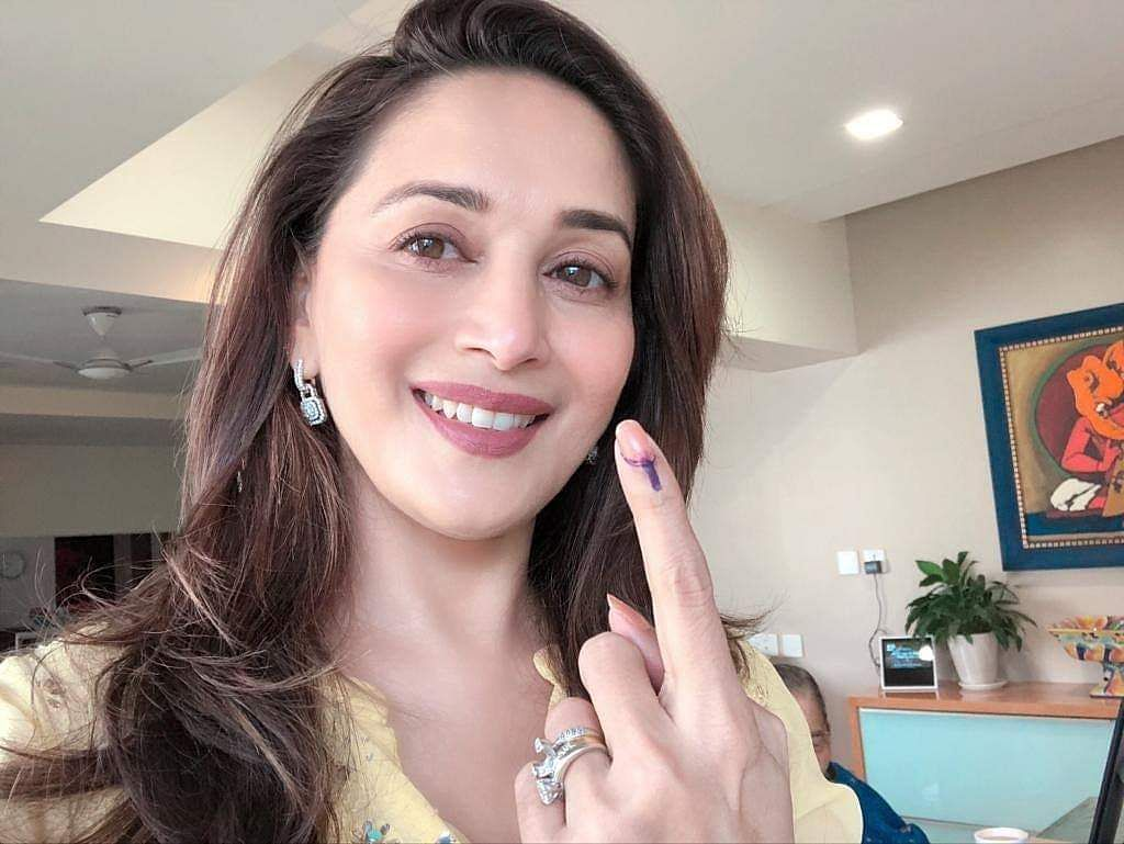 Madhuri Dixit showing her inked finger.