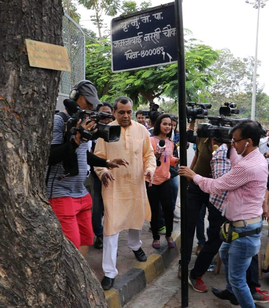 Paresh Rawal surounded by media after voting.