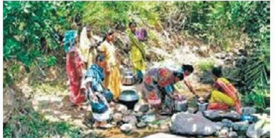 Women have to trek 2 km to fetch water from a nullah at the foothills of Chandangiri