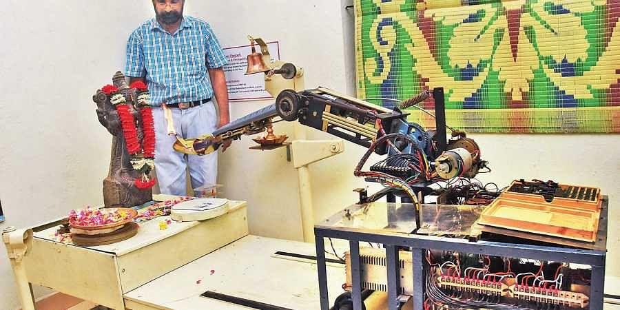 V S Sabu watches as the robot performs puja at his lab near Thiruvallam in Thiruvananthapuram | B P Deepu