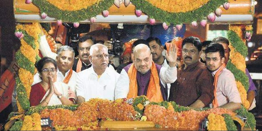 BJP chief Amit Shah holds a road show at Banashankari in Bengaluru on Tuesday. Tejaswini Ananth Kumar, V Somanna, state party president B S Yeddyurappa,  R Ashoka and party candidate Tejasvi Surya accompanied him