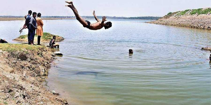 A youngster dives into Bethamangala Lake to beat the summer heat. This  is one of the few lakes in Kolar district that have not dried up this season