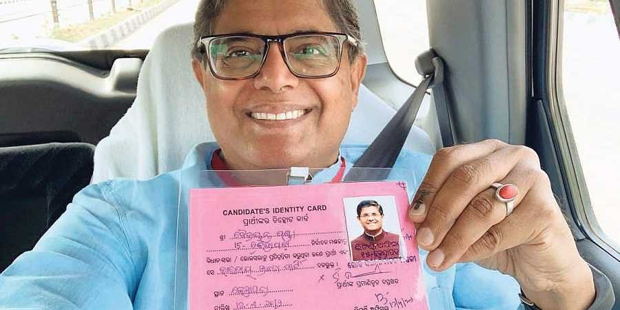BJP's candidate for Kendrapara Lok Sabha constituency Baijayant Panda on his way to a booth on Monday
