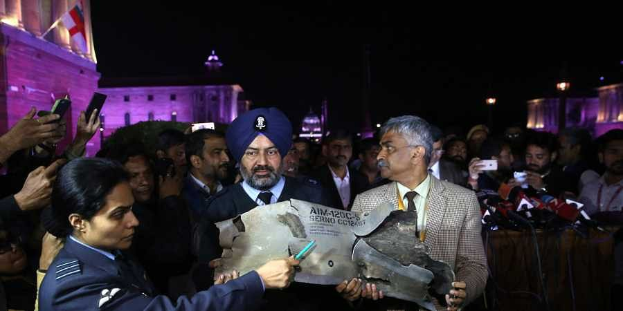 Indian Air Force officials show sections of an exploded Amraam missile said to be fired by Pakistan Air Force F-16s at an IAF, Army and Navy joint press conference at South Block in New Delhi on Thursday.