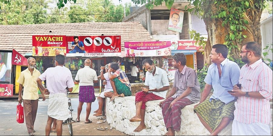 A group of villagers engaged in a heated political discussion at Aiyur near Perumbavoor