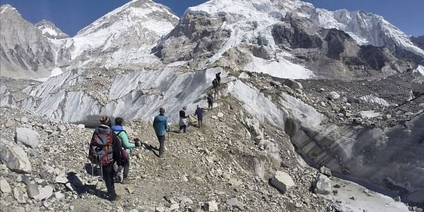 FILE - In this Monday, Feb. 22, 2016 file photo, trekkers pass through a glacier at the Mount Everest base camp, Nepal. (Photo | AP)