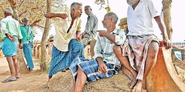 A group of veteran fishermen - Pathrose, Lesli, Roland, Tony and Gregory - engaged in a heated political debate which has all the makings of a brawl, at Valiyathura Junction in the state capital