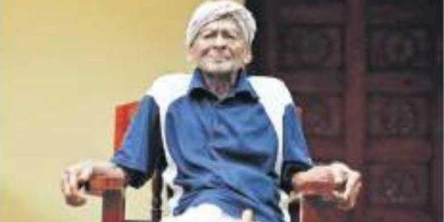110-year-old Govinda Pillai in front of his house in Moonnattumukhom