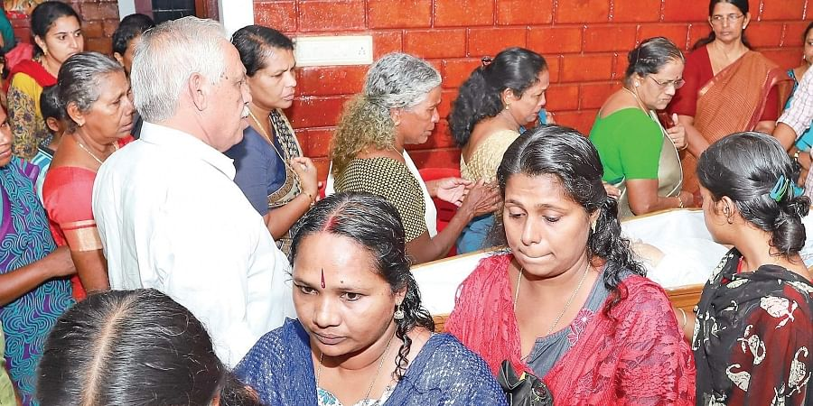 People who gathered at the house of the seven-year-old boy's grandmother at Udumbannoor seem inconsolable as they queue up to pay last respects