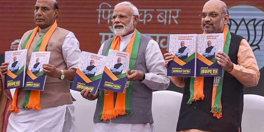 Prime Minister Narendra Modi BJP President Amit Shah and Union Home Minister Rajnath Singh release Bharatiya Janata Party's manifesto Sankalp Patra for Lok Sabha elections 2019 in New Delhi. (Photo | PTI)