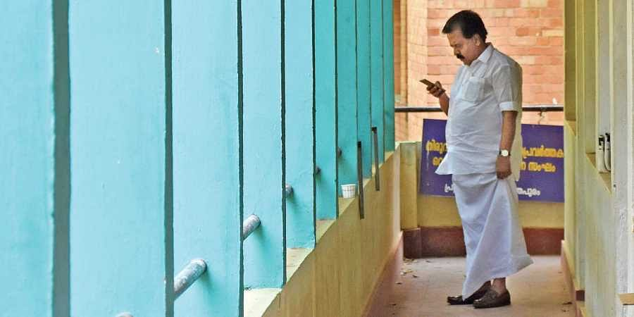 Opposition leader Ramesh Chennithala seen busy with his mobile phone just before speaking to journalists at the meet-the-press programme (Janayatham-2019) organised by Thiruvananthapuram Press Club on Monday