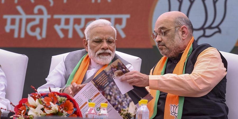 Prime Minister Narendra Modi and BJP President Amit Shah after the release of Bharatiya Janata Party's BJP manifesto Sankalp Patra for Lok Sabha elections 2019 in New Delhi. (Photo | PTI)