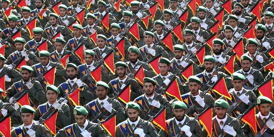 Iran's Revolutionary Guard troops march in a military parade