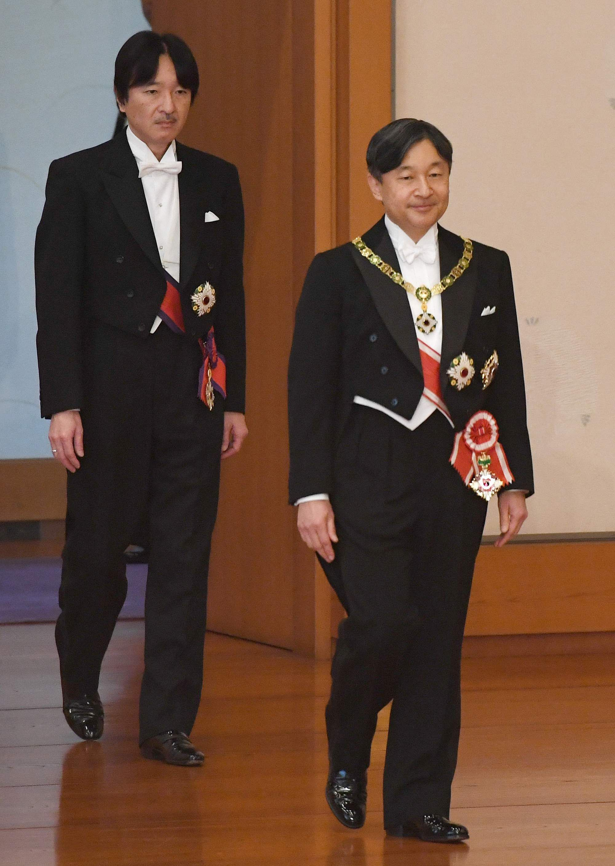 Japan's new Emperor Naruhito, right, followed by Crown Prince Akishino, walks for the ceremony to receive the Imperial regalia of sword and jewel as proof of succession at Imperial Palace in Tokyo, Wednesday, May 1, 2019.