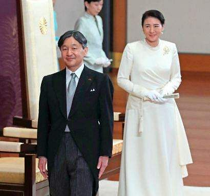 Japan's new Emperor Naruhito, accompanied by new Empress Masako, leaves after making his first address during a ritual after succeeding his father Akihito at Imperial Palace in Tokyo, Wednesday, May 1, 2019.