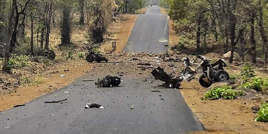 Mangled remains of a police vehicle carrying 16 security personnel that was allegedly blasted by Maoists using IED in Gadchiroli, Maharashtra on 1 May 2019.