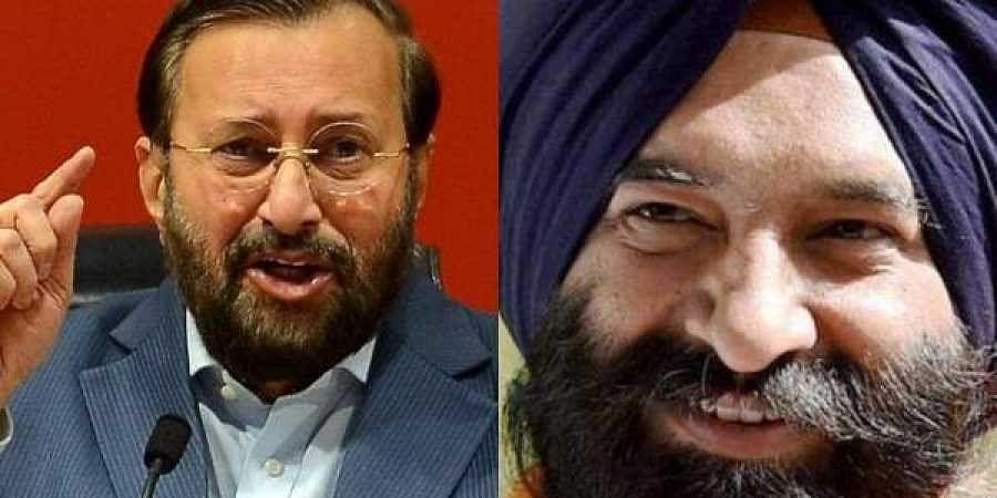 BJP leader Prakash Javadekar(L) and SAD leader Manjinder Singh Sirsa