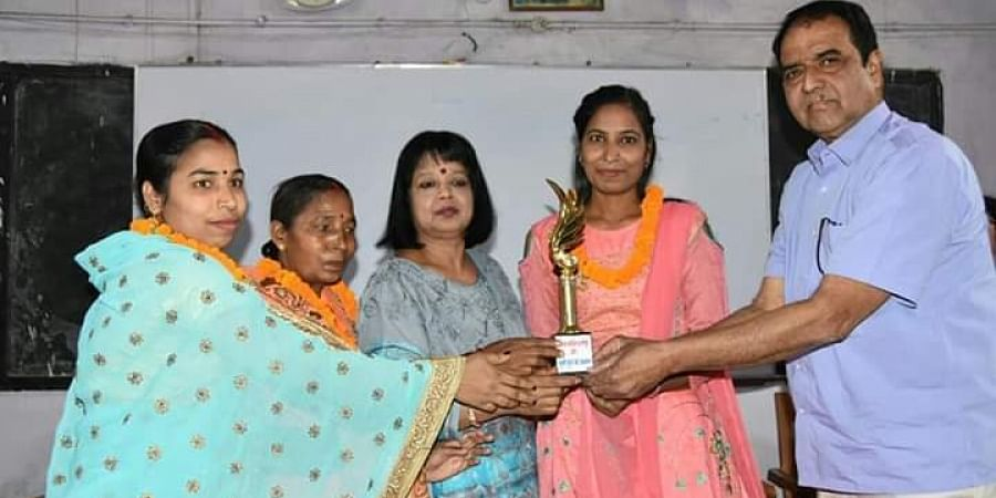 Sudha(in pink) is felicitated in her alma mater | EPS