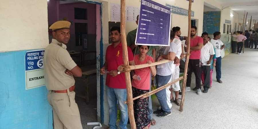 Voters waiting in queue to cast their votes at a polling station in New Delhi. (Photo  Shekhar Yadav/ EPS)