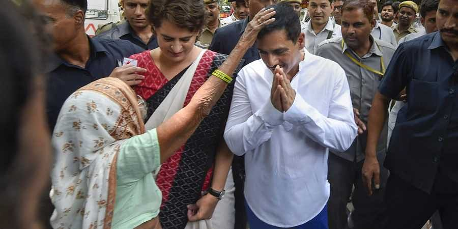 Priyanka Gandhi and Robert Vadra get blessed by an elderly voter after they cast their votes in New Delhi on 12 May 2019. (Photo | Shekhar Yadav, EPS)