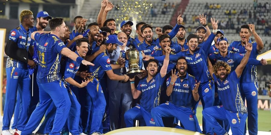 MI players celebrate with the IPL 2019 trophy after winning the final match against Chennai Super Kings. (Photo | PTI)