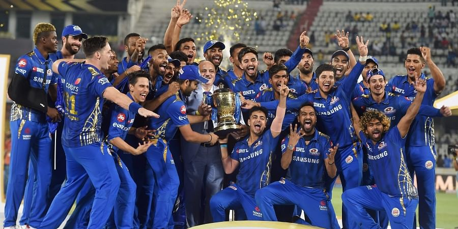 MI players celebrate with the IPL 2019 trophy after winning the final match against Chennai Super Kings. (Photo   PTI)