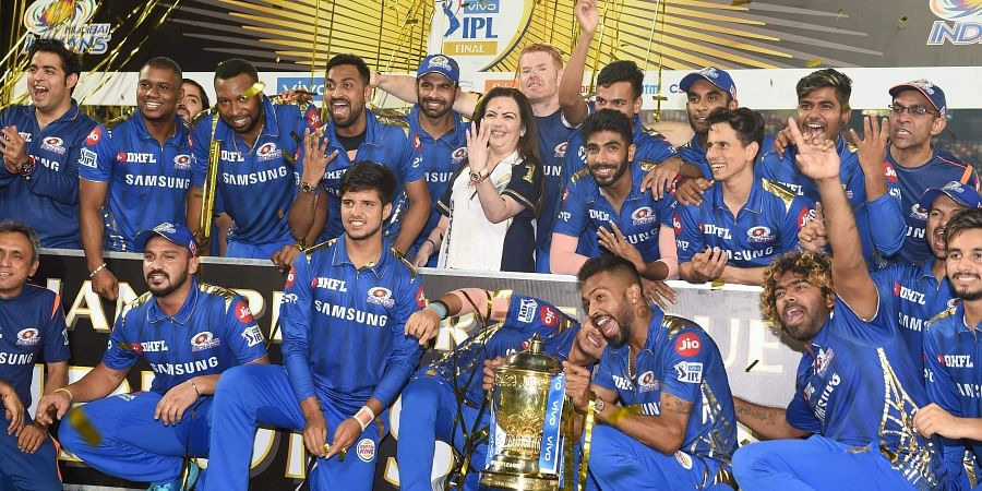MI owner Nita Ambani along with players celebrate with the IPL 2019 trophy after winning the final match against Chennai Super Kings. (Photo | PTI)