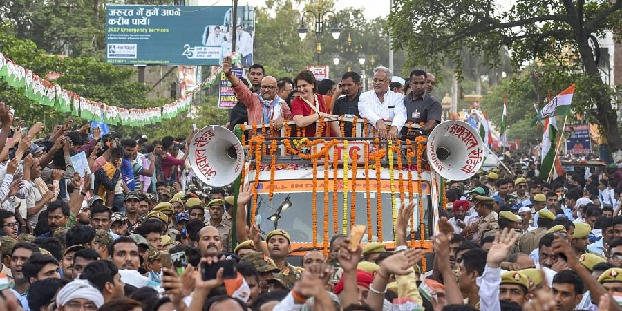 Congress General Secretary Priyanka Gandhi Vadra along with the party candidate Ajay Rai and Chhattisgarh CM Bhupesh Singh Baghel during a roadshow for the Lok Sabha polls in Varanasi. (Photo | PTI)