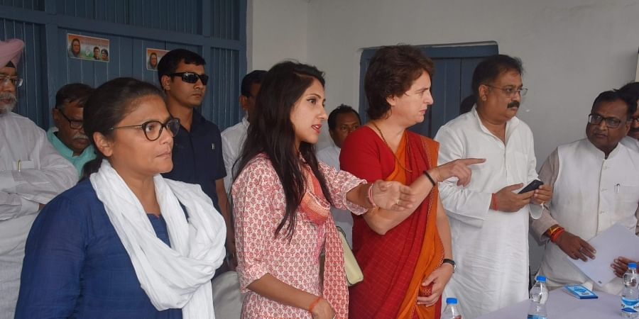 Congress General Secretary Priyanka Gandhi Vadra interacts with party workers and leaders during a meeting at Tilak Bhawan in Rae Bareli. (Photo   PTI)