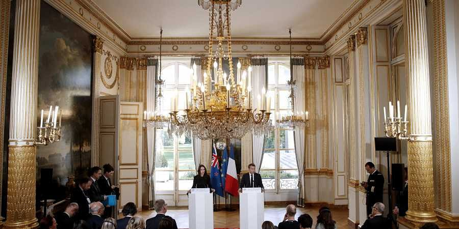 New Zealand Prime Minister Jacinda Ardern(L) and French President Emmanuel Macron hold a press conference at the Elysee Palace in Paris