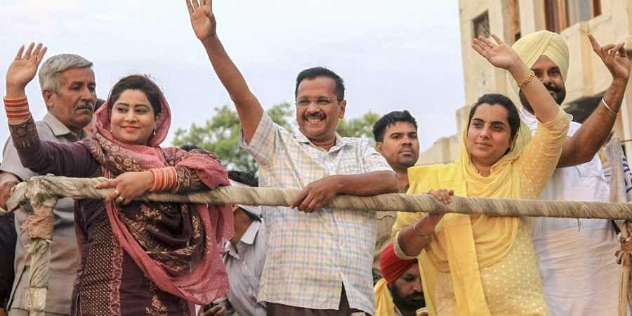 Delhi CM and AAP convenor Arvind Kejriwal with party's Bathinda seat candidate Baljinder Kaur and AAP MLA from Bathinda Rural Rupinder Kaur Ruby during an election roadshow for Lok Sabha polls in Bathinda. (Photo | PTI)