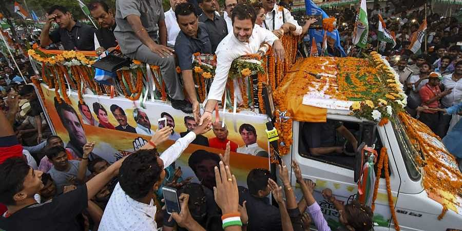 Congress President Rahul Gandhi with party candidate from Patna Sahib Shatrughan Sinha during a roadshow for the seventh and last phase of Lok Sabha polls in Patna