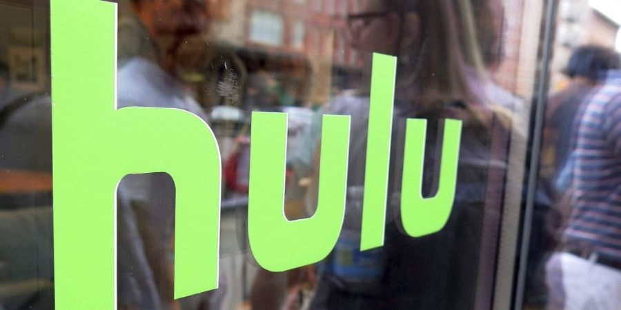 The Hulu logo is seen on a window at the Milk Studios space in New York. Disney has struck a deal with Comcast that gives it full control of streaming service Hulu. (Photo | AP)
