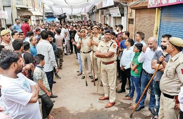 Police stand guard in Moti Nagar area in the wake of protests after businessman Dhruv Tyagi's murder in West Delhi's Basai Darapur village. (Photo   EPS)