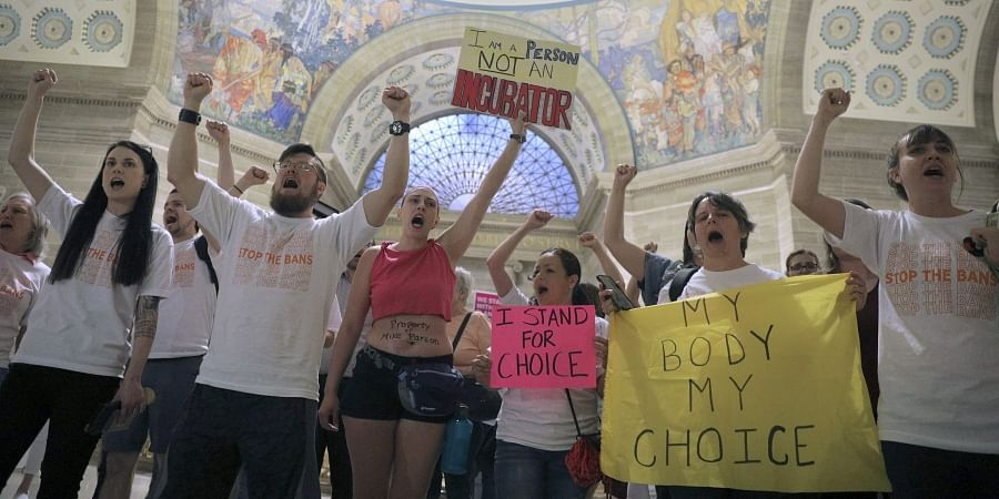 Abortion-rights activists react after lawmakers approved a sweeping piece of anti-abortion legislation, a bill that would ban most abortions in the state of Missouri, Friday, May 17, 2019 in Jefferson, Mo.