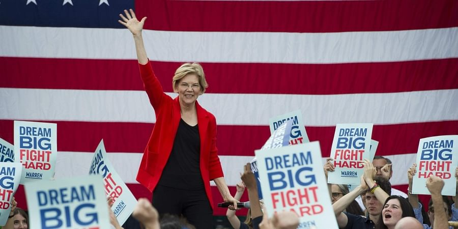Democratic presidential candidate Sen. Elizabeth Warren, D-Mass., addresses a campaign rally at George Mason University in Fairfax, Va. Warren is gaining traction with black women debating which Democratic presidential candidate to back in a historically diverse primary.