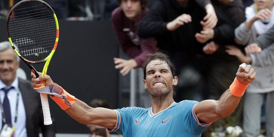 Rafael Nadal of Spain celebrates after defeating Stefanos Tsitsipas of Greece during a semifinal match at the Italian Open tennis tournament in Rome