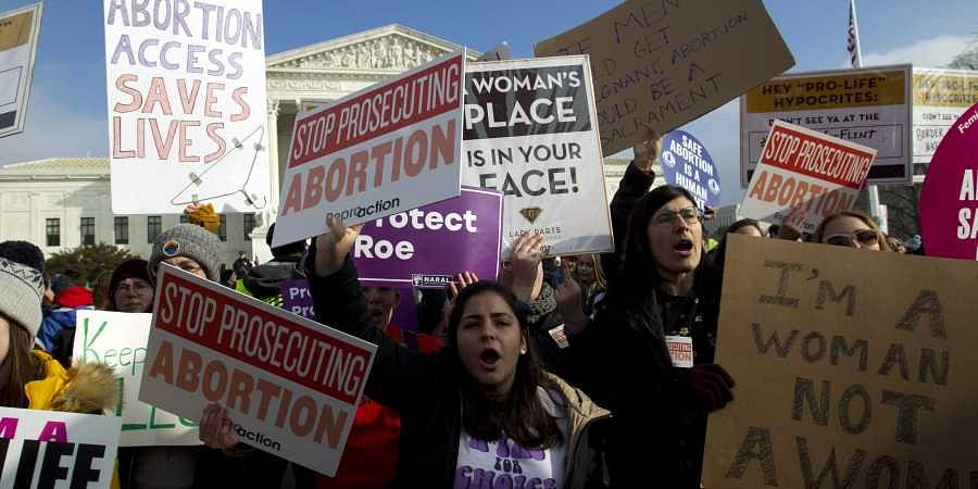Abortion-rights activists protest outside of the U.S. Supreme Court, during the March for Life in Washington. (Photo | AP)