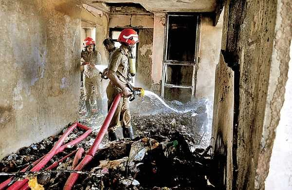 Fire and Rescue Services personnel dousing the fire caught on the garbage dumped on the top floor of Swapnil Apartments on Kaloor-Kadavanthra road in Kochi on Saturday (Photo  A Sanesh/EPS