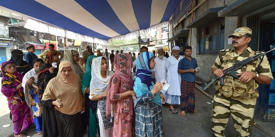Muslim women wait at a polling station to cast their votes for the seventh and last phase of Lok Sabha elections in Kolkata. (Photo | PTI)