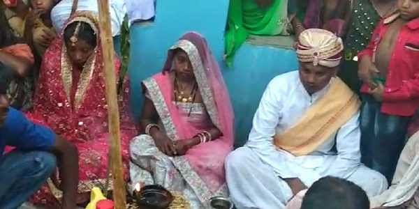 Anil Paikra sitting in the wedding mandap with his wife and lover  Baghdol gram panchayat in Jashpur district of Chhattisgarh. (Photo   EPS)