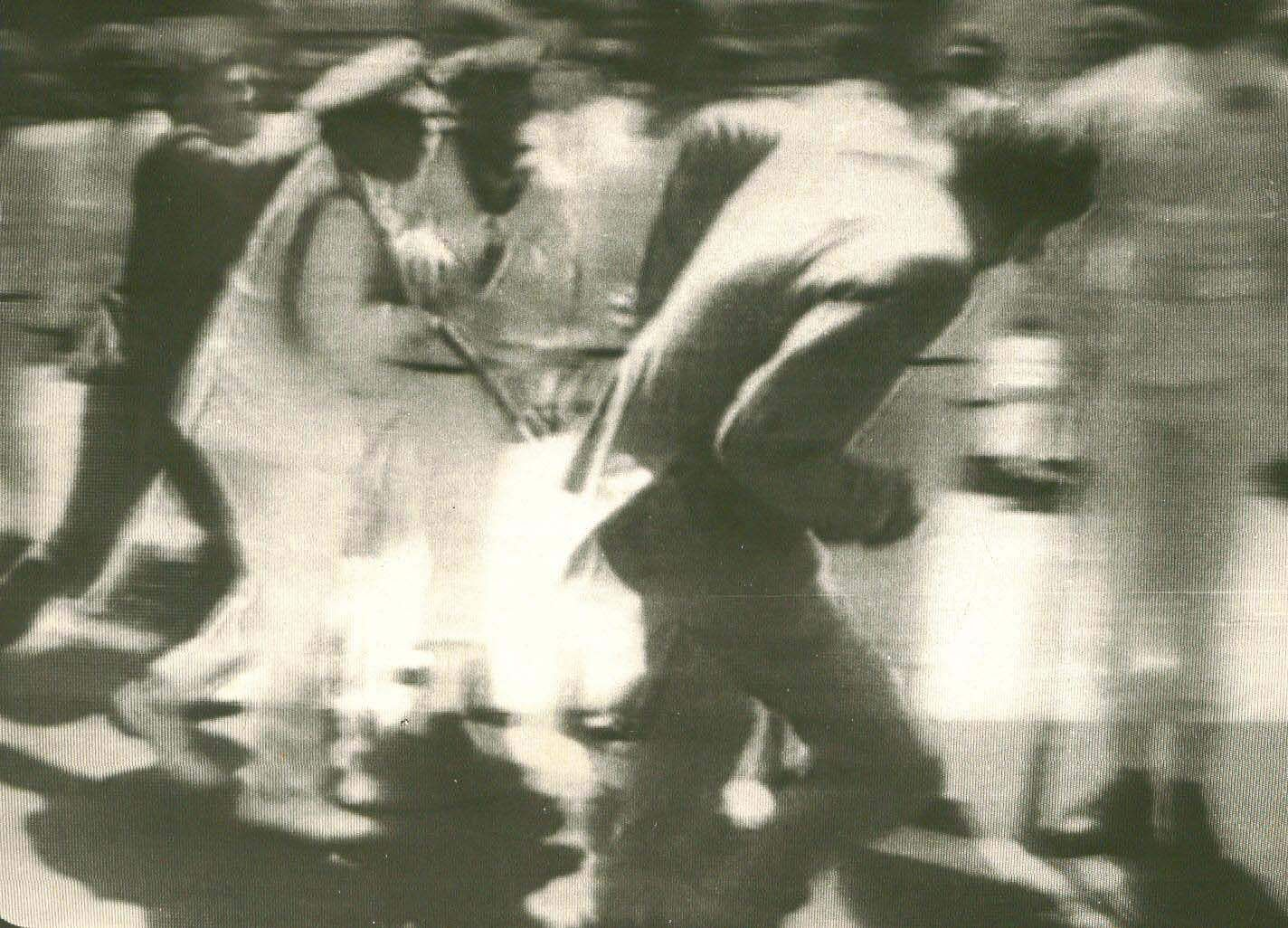 A Sri Lankan sailor attempt to hit Prime Minister Rajiv Gandhi with his rifle butt during his   visit to Colombo - Express Photo.