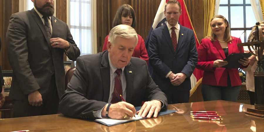Missouri Governor Mike Parson signs one of the nation's most restrictive abortion bills, banning the procedure on or beyond eight weeks of pregnancy