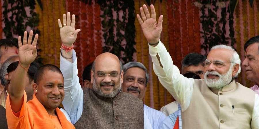 (From Left) Uttar Pradesh CM Yogi Adityanath, BJP president Amit Shah and PM Narendra Modi