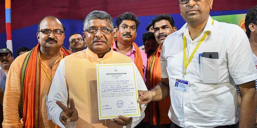 Union Law Minister  Ravi Shankar Prasad receives the winning certificate following his victory in Bihar's Patna Sahib in the Lok Sabha elections on 23 May 2019.